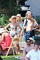 derek hough goes shirtless while paddling at julianne rehearsal party 02