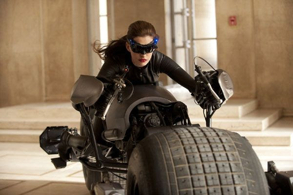 Catwoman (played by Anne Hathaway) rides the Batpod in THE DARK KNIGHT RISES.