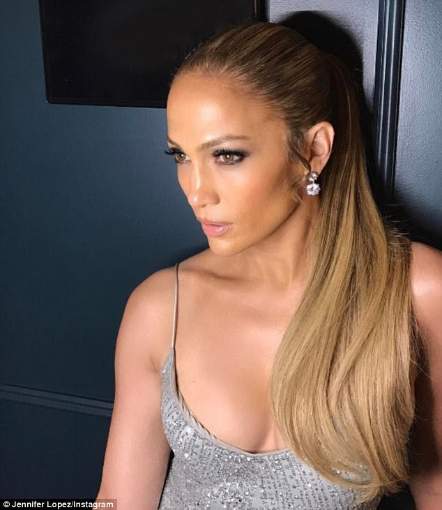 Bringing the va va voom!Jennifer Lopez wowed in plunging silver tank top with sequins that flashed plenty of cleavage in a snap she shared on Thursday evening