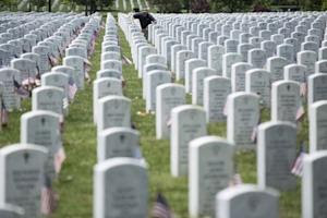 A man pauses at a grave during Memorial Day celebrations at Arlington National Cemetery