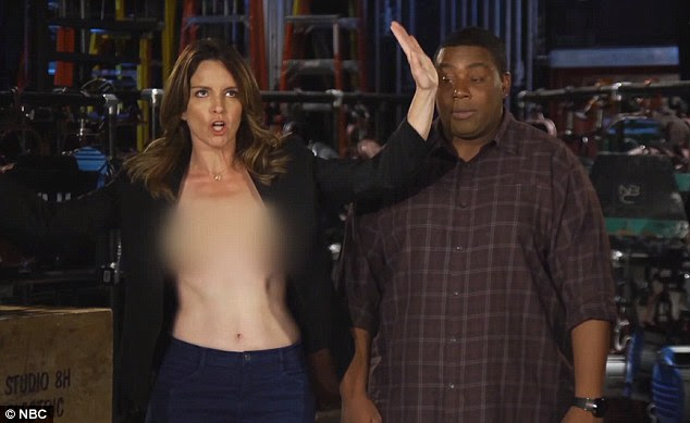 It's all under control! Tina makes light of her Emmy Awards wardrobe malfunction in the promo for Saturday Night Live