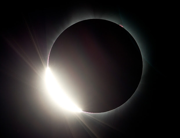 The moon almost eclipses the sun during a near total solar eclipse as seen from Salem, Ore., Monday, Aug. 21, 2017. (AP Photo/Don Ryan)