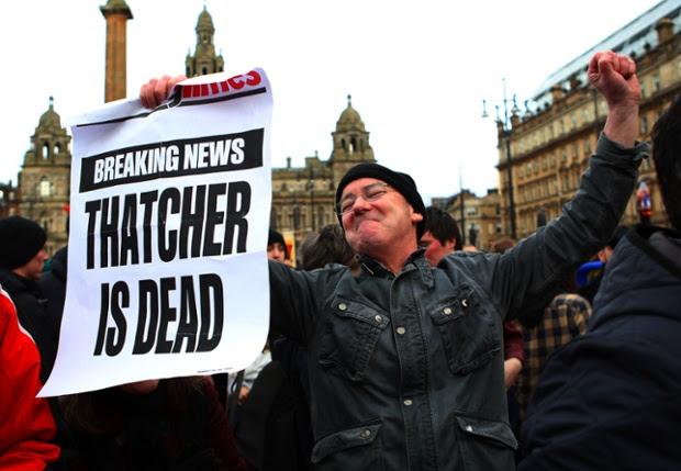 A man reacts as he attends a gathering of people celebrating the death of former British prime minister Margaret Thatcher, in George Square in Glasgow, Scotland.
