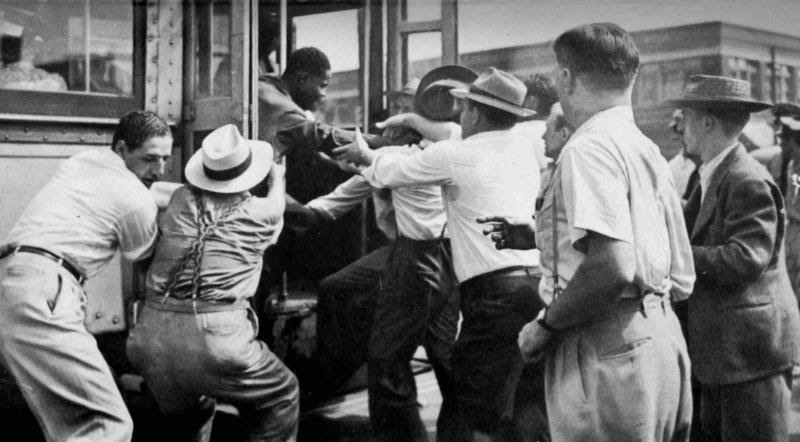 http://atlantablackstar.com/wp-content/uploads/2013/12/A-white-mob-attempts-to-abduct-a-black-man.jpg