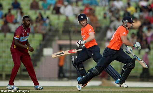 In vain: Stand-in captain Eoin Morgan (centre) runs between the wickets during England's defeat