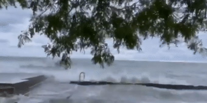 Powerful wind-driven waves batter Chicago's lakeshore
