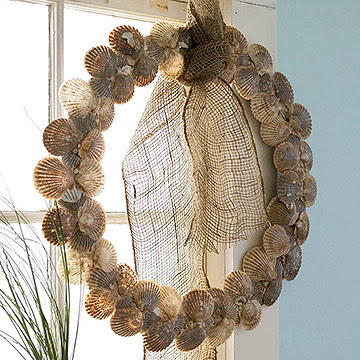 Shell wreath hanging from window