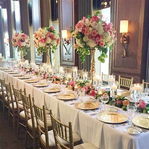 Posh Floral Designs   Long table design for a wedding