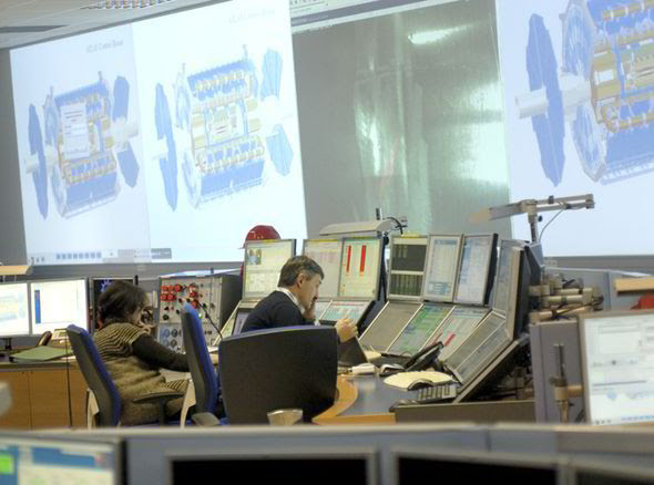 A scientist works within the ATLAS control room, part of the Large Hadron Collider facility