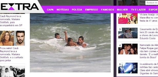 27.mar.2016 - Cauã Reymond (à esq) ajuda a salvar criança de afogamento em praia carioca