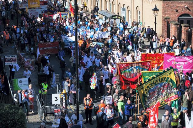 Around 50,000 marched through Manchester in protest at the government's austerity measures as the Conservative Party conference began