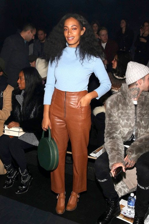 Le Fashion Blog Celebrity Style Solange Knowles Blue Mock Neck Top Tibi High Waisted Leather Pants Mansur Gabriel Circle Tote Via Billboard