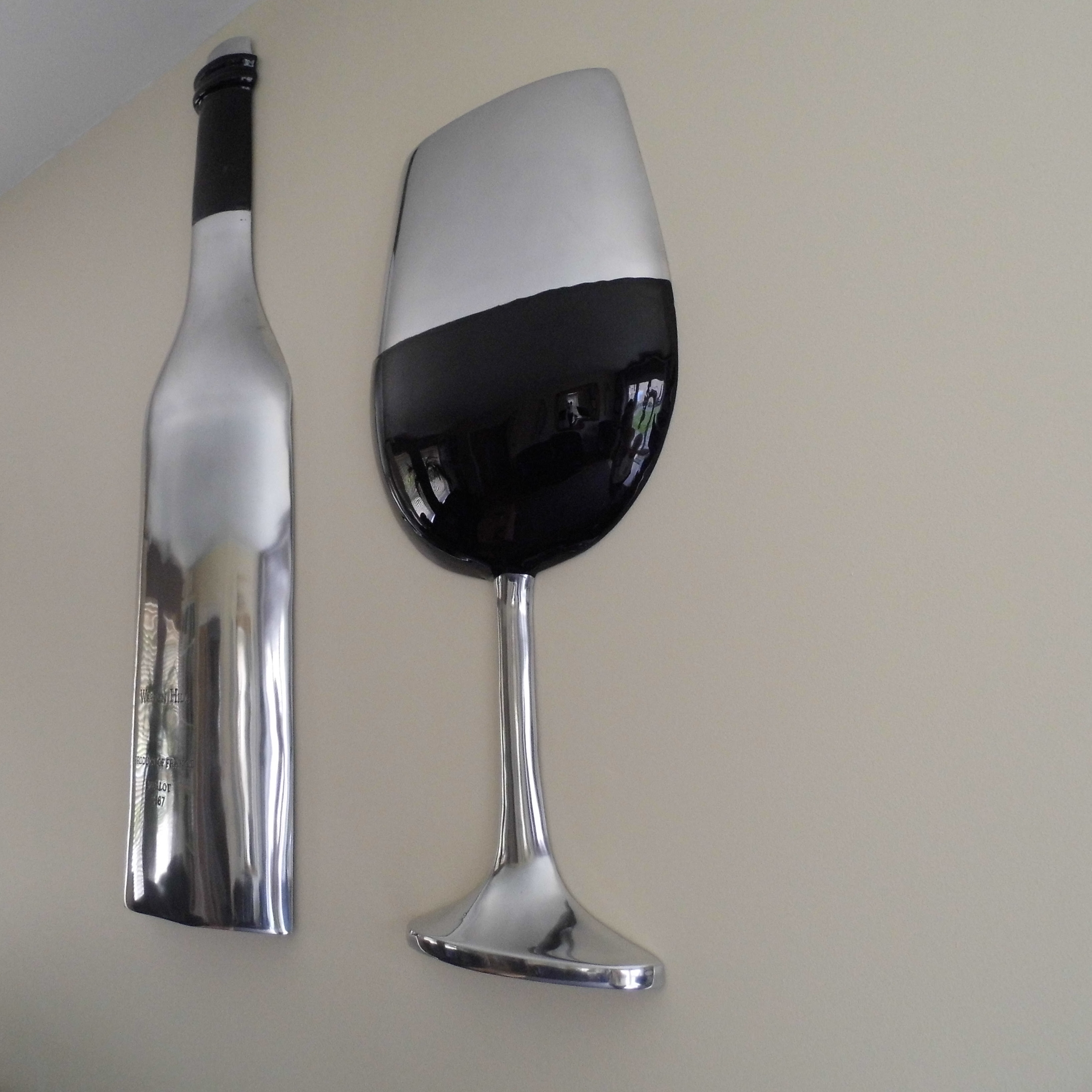 Bottle and Glass on the wall
