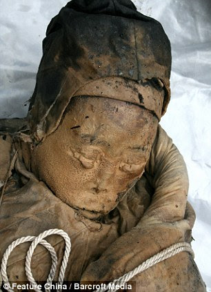 Amazing discovery: The 700-year-old mummy was found in the city of Taizhou, in Jiangsu Province, by construction workers - and her eyebrows were still intact