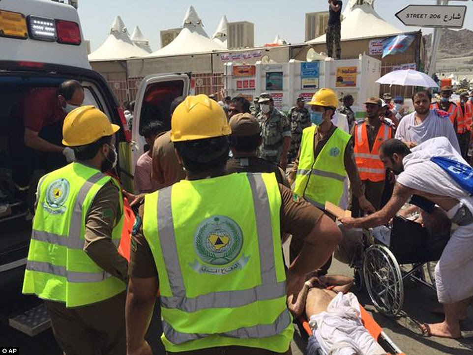 Terrifying: Pictures and video revealed a horrific scene, with scores of bodies – the men dressed in the simple terry cloth garments worn during Hajj – lying amid crushed wheelchairs and water bottles along a sunbaked street