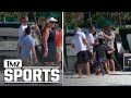Tampa Bay Lightning fans drink from Stanley Cup at Florida beach party