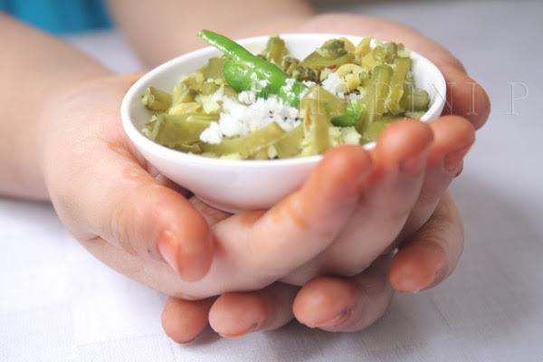 Broad beans in Aarya's hands