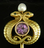 Antique stickpin of entwined serpents guarding an amethyst. (J9083)