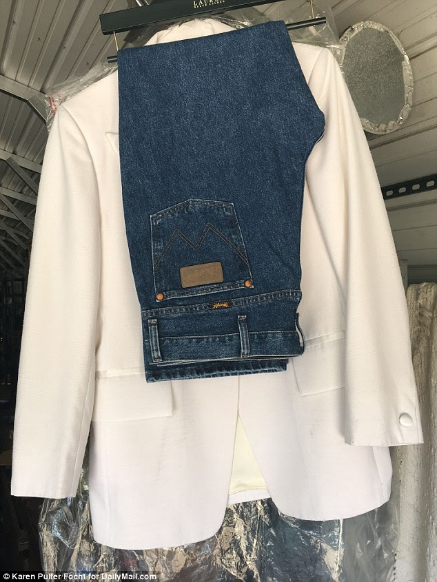 The expensive white show jacket is seen here, next to a pair of blue jeans