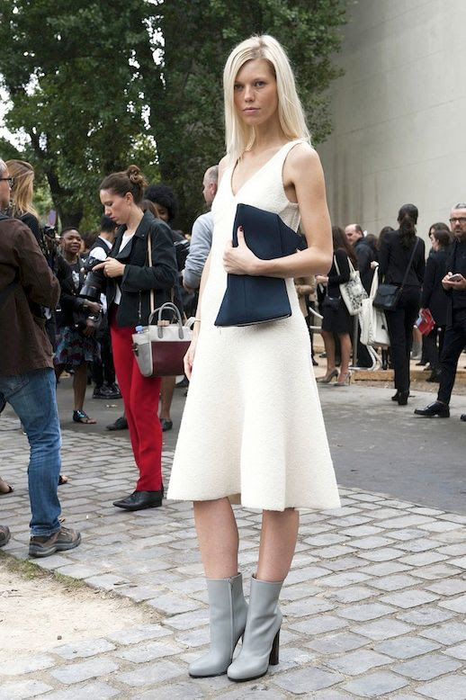 Le Fashion Blog Street Style Pfw White Dress Black Clutch Light Grey Heeled Boots Via Popsugar