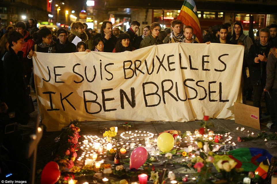 Je Suis Bruxelles:People hold up a banner as a mark of solidarity at the Place de la Bourse following today's attacks  in Brussels, Belgium