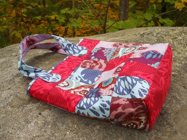 patchwork bag on a rock