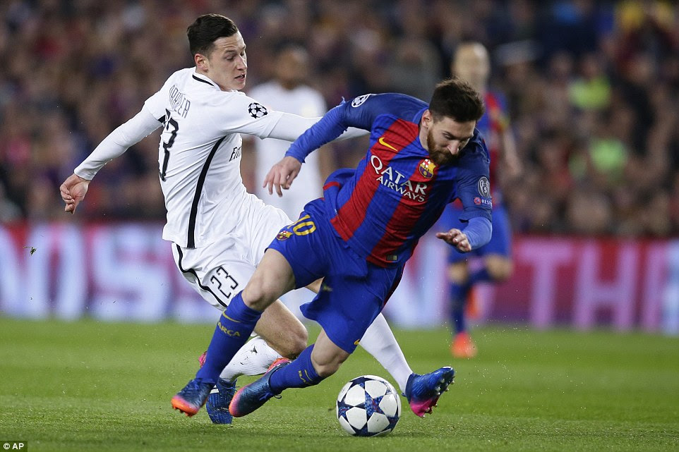 Lionel Messi attempts to spin past the challenge of PSG winger Julian Draxler but is sent tumbling by the German