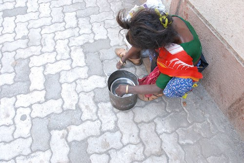 searching for hope in a few coins in a beggars bowl by firoze shakir photographerno1