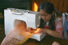 Sophia Sewing a Rebozo
