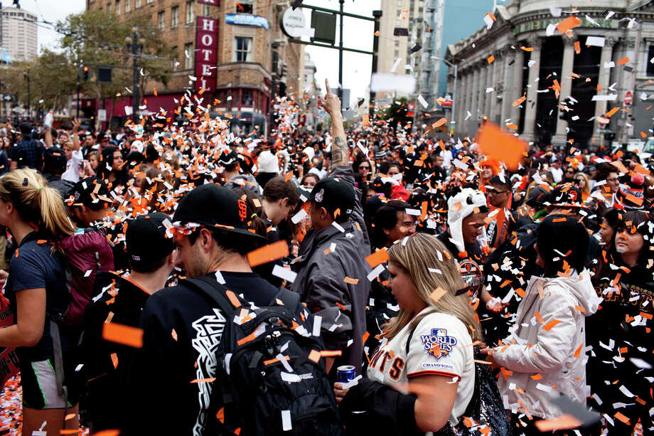 Fans party during the parade that followed the Giants' 2012 World Series Championship on Oct. 31, 2012, in San Francisco. Photo: Jason Henry / Special To The Chronicle / ONLINE_YES