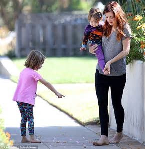 Alyson Hannigan goes barefoot as she jumps at the chance