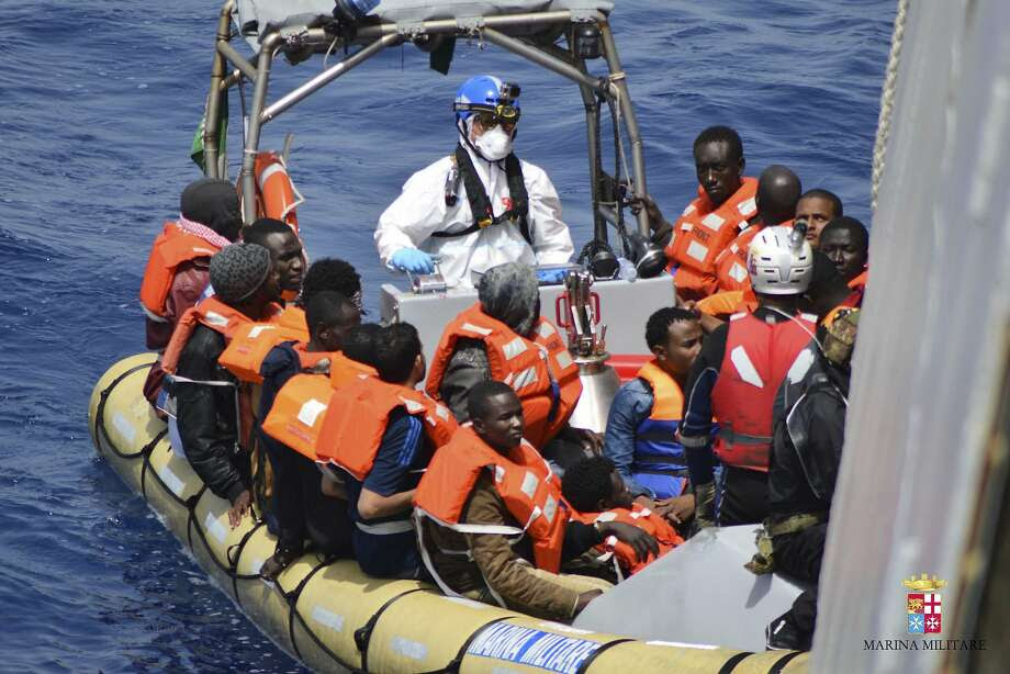 The Italian navy rescues shipwrecked refugees crossing from Libya to Italy in Mediterranean Sea despite calm seas and sunny skies. Photo: Associated Press