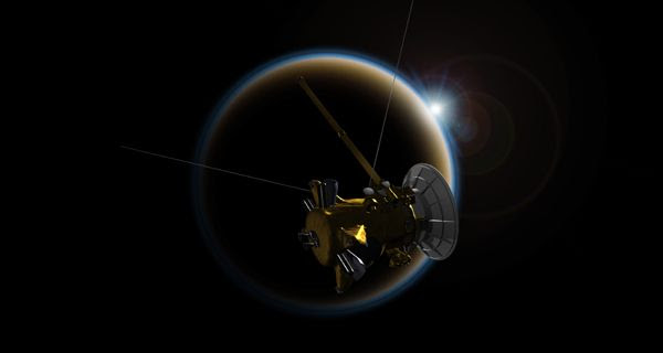 An artist's concept of NASA's Cassini spacecraft making one last flyby of Saturn's moon Titan on September 11, 2017.