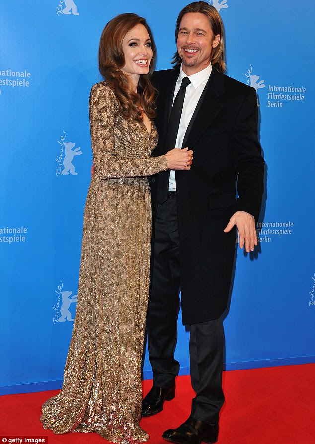 From actor to director: Angelina at the premiere of her film 'In The Land Of Blood And Honey', which she directed, at the Berlin Film Festival with Brad in 2012
