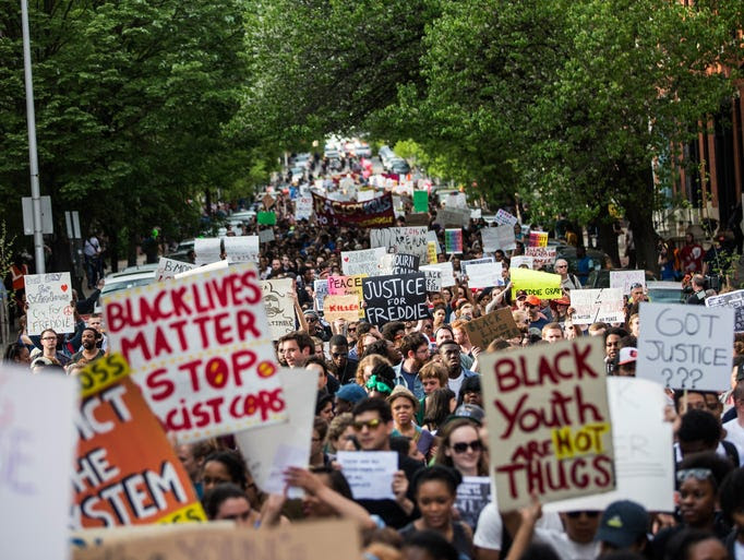 Students from Baltimore colleges and high schools march
