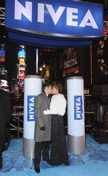 "Musician Nick Lachey and Vanessa Minnillo, co-hosts of the NIVEA Kiss Platform, share a kiss in Times Square on New Year's Eve where they rang in 2010 as a year of ""Love, Hugs and Kisses"" on December 31, 2009 in New York City."