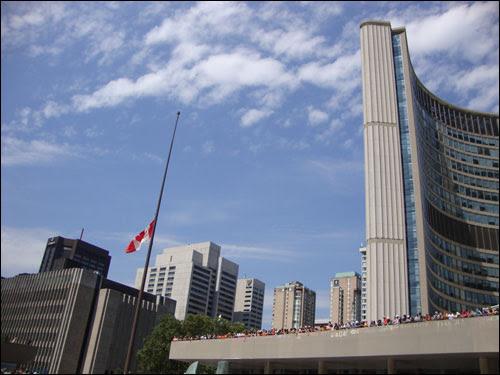 Jack Layton mourners at Toronto City Hall, Canadian flag at half mast