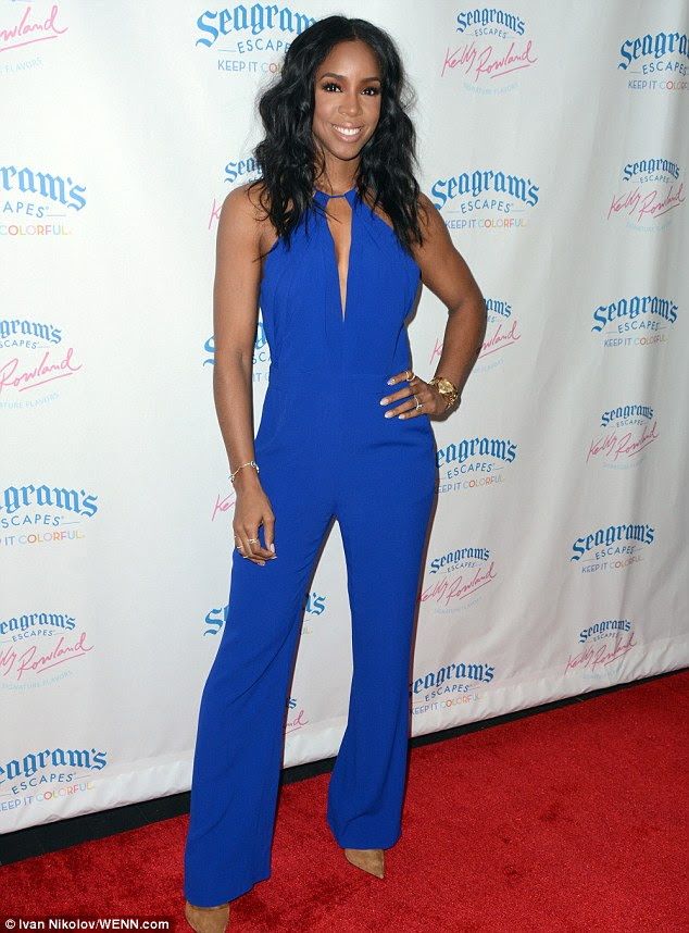 Electrifying: Kelly Rowland sported a flattering blue jumpsuit as she helped promote Seagram's Escapes in New York on Wednesday