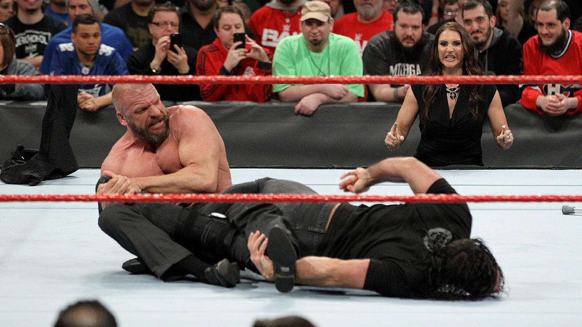 Triple H takes him out with a crutch and locks in a submission hold.
