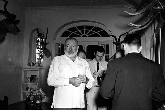 American novelist Ernest Hemingway meets the press at his Cuban home in San Francisco de Paula, a suburb of Havana, October 28, 1954, after announcement was made that he is awarded the 1954 Nobel Prize in literature. Hemingway said he