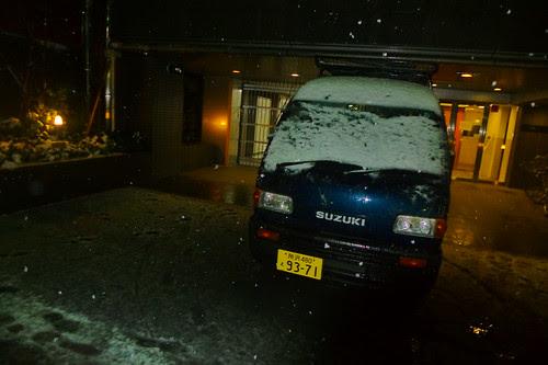Van covered in snow