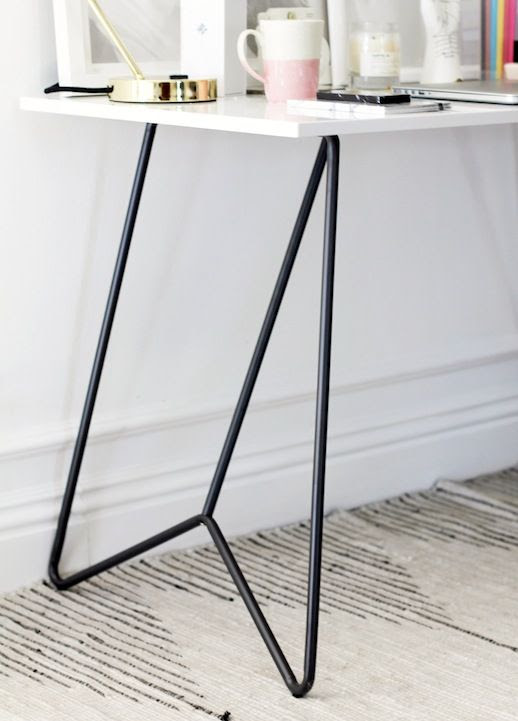 Le Fashion Blog Stylish Whimsical Work Space Urban Outfitters Architectural White Modern Desk Black Metal Legs Striped Rug
