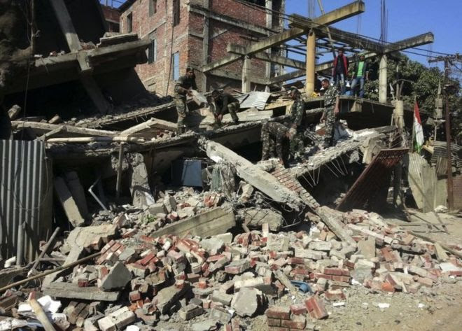 Indian soldiers remove debris from a house that collapsed in an earthquake in Imphal, capital of the north-eastern Indian state of Manipur, Monday, Jan. 4, 2016.
