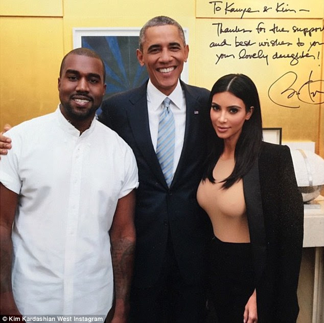 Plenty to smile about: President Barack Obama embraced Kim Kardashian and Kanye West in a 'flashback' photo (taken in October) the reality star shared with fans on Instagram on Friday