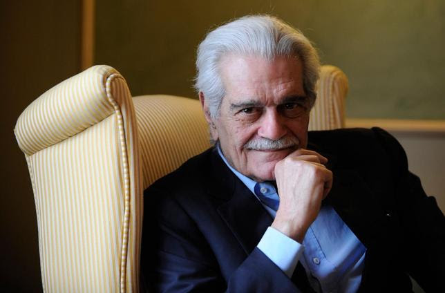 Egyptian actor Omar Sharif poses for a photograph during the presentation of his latest film entitled ''Disparadme'' at a hotel in Aviles, northern Spain, in this file photo from June 16, 2009. REUTERS/Eloy Alonso/Files