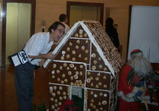 Charles in front of the same Gingerbread house, not behaving as he tries to take a bite