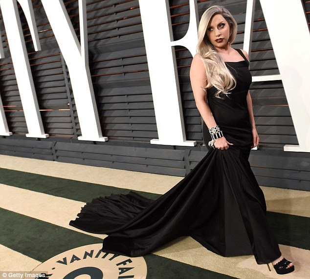 Soaring to new heights: The chart-topping singer stood tall in a pair of black peep-toe heels