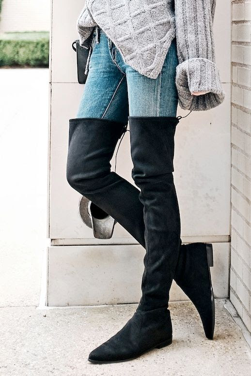 Le Fashion Blog Blogger Style Oversized Cable Knit Sweater Light Wash Skinny Denim Stuart Weitzman Suede Over The Knee Boots Via Sea Of Shoes