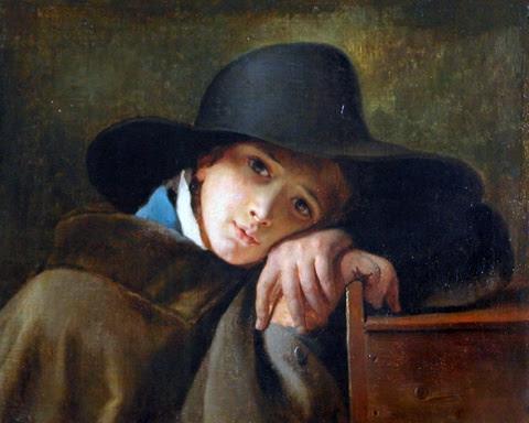 Jeune garçon songeur