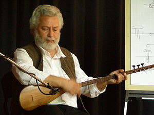 Erkan Oğur holding a kopuz lute in April 2007,...